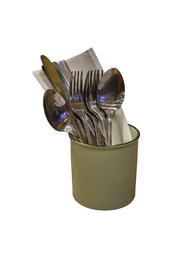 Isolerad sked, gaffel och kniv i ett exponeringsglas av zink på en vit bakgrund med urklippbanan royaltyfria bilder