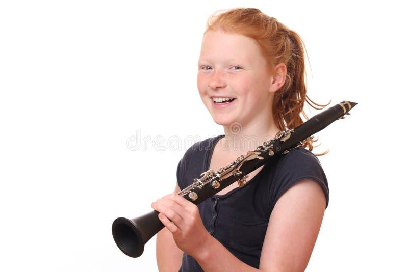 isolerad spelarewhite för bakgrund klarinett royaltyfri bild