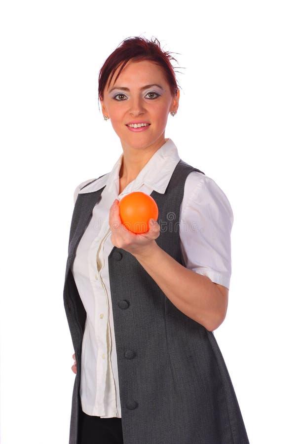 isolerad stressball för affärskvinna elegant holding royaltyfria foton
