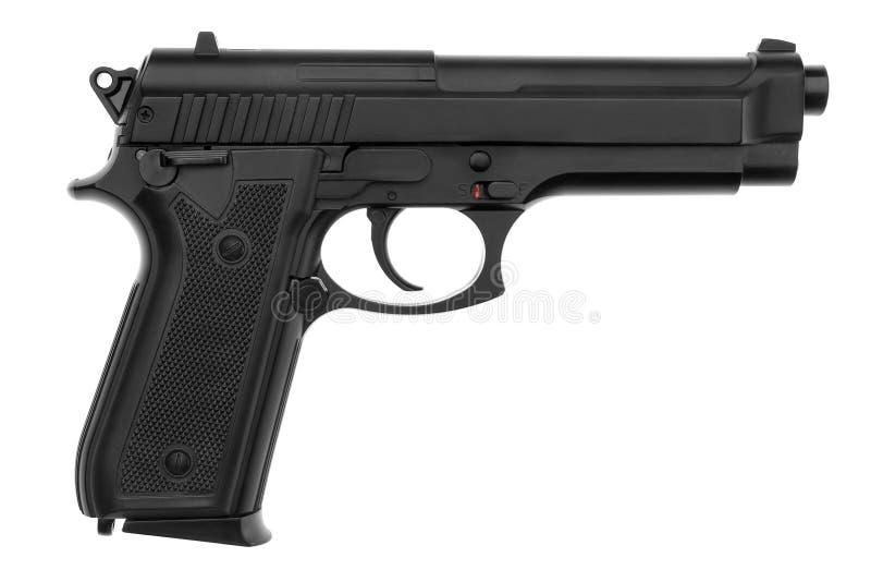 Isolerad svart pistol arkivfoton