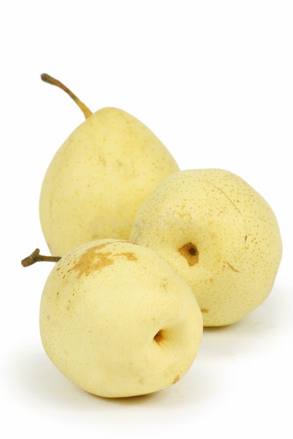 isolerad yellow för pears tre fotografering för bildbyråer