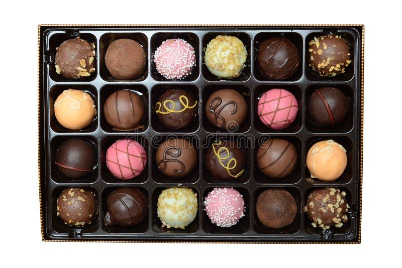 Isolerade askar av ball form choklad arkivfoto