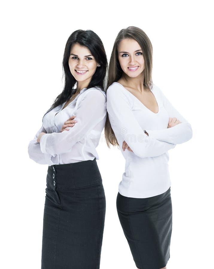 Isolerade den unga lyckade attraktiva kvinnan för affär två vit bakgrund royaltyfri foto