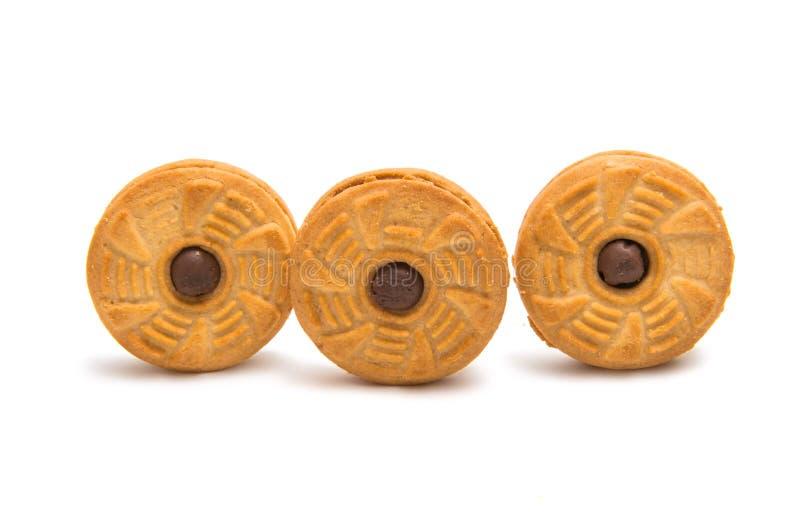 Isolerade fyllda kräm- kakor arkivfoto