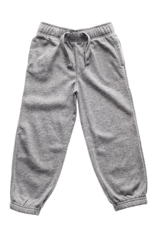 Isolerade gråa sweatpants arkivbild