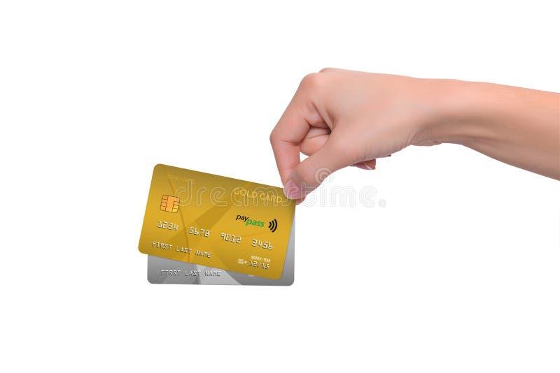 Isolerade guld- och grå färgkreditkortar i hand royaltyfri foto
