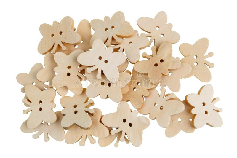 Isolerade hemlagade fjärilar för påskgarneringar som göras av trä arkivfoto