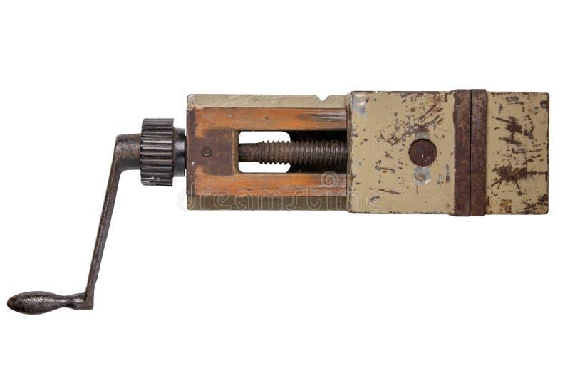 isolerade hjälpmedel skruvstäd Bästa sikt på stor metallskurkroll industriellt v arkivfoto