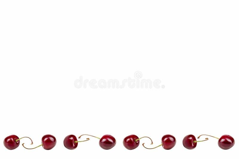 Isolerade körsbär Samling av frukter för söt körsbär som isoleras på vit bakgrund med den snabba banan Top beskådar bär arkivfoton