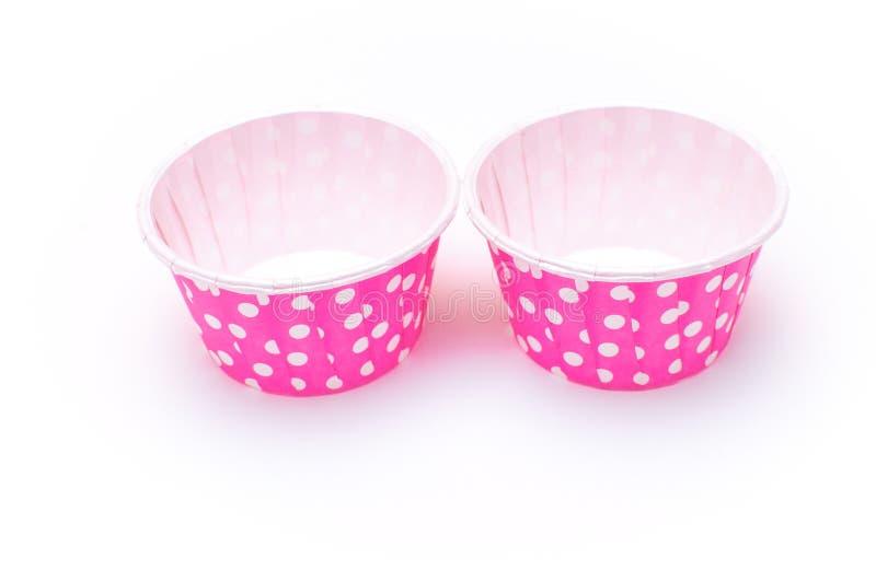 Isolerade pappers- koppar för rosa prick royaltyfria foton