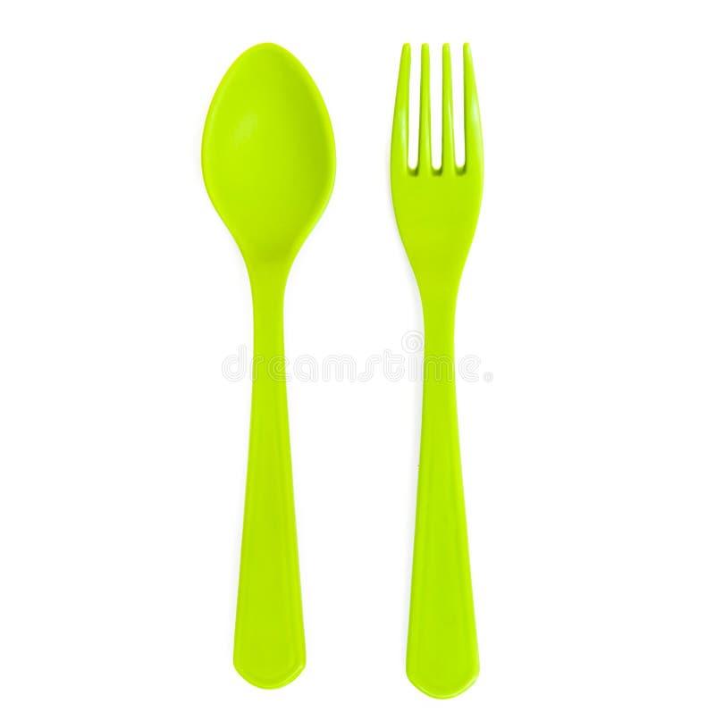 Isolerade plast-gräsplansked och gaffel arkivbilder