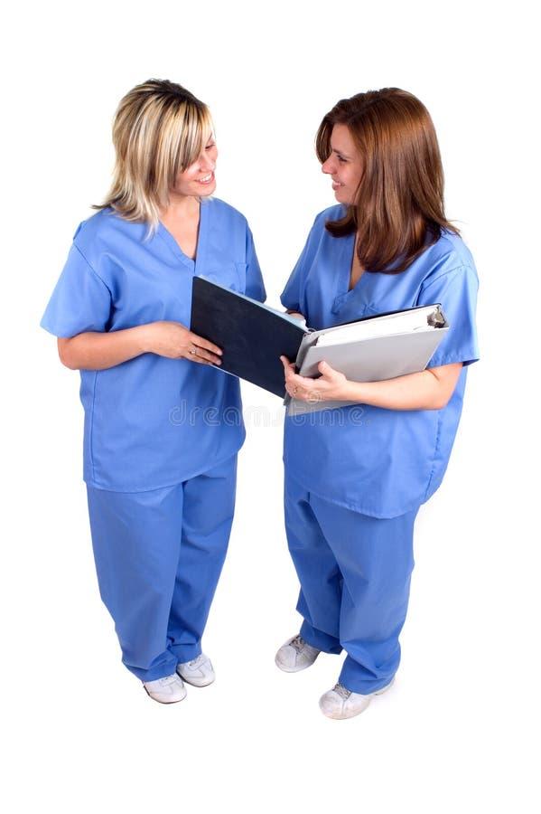 isolerade sjuksköterskor två royaltyfri bild