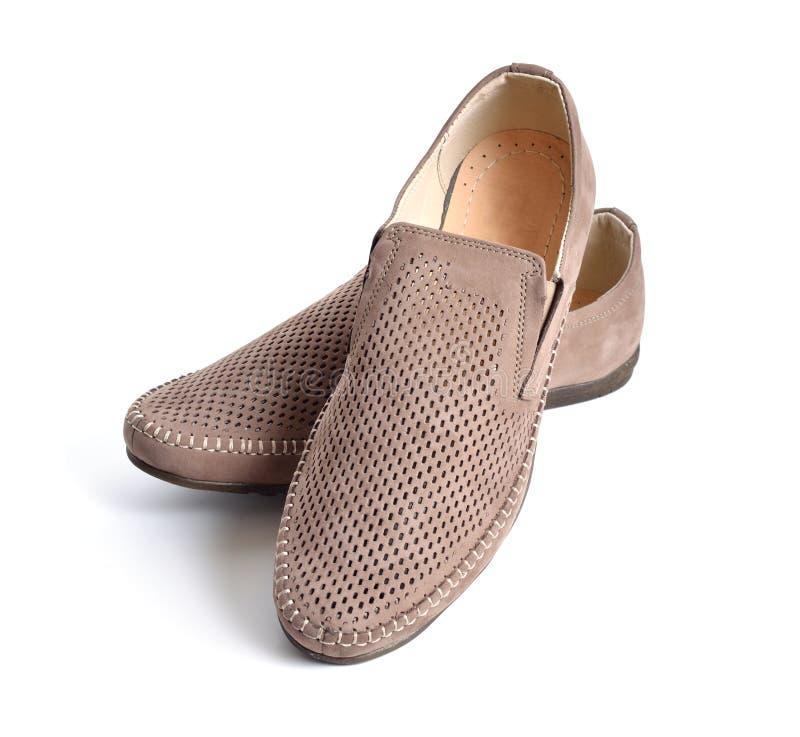 Isolerade skor för läderman` s med perforering arkivfoton