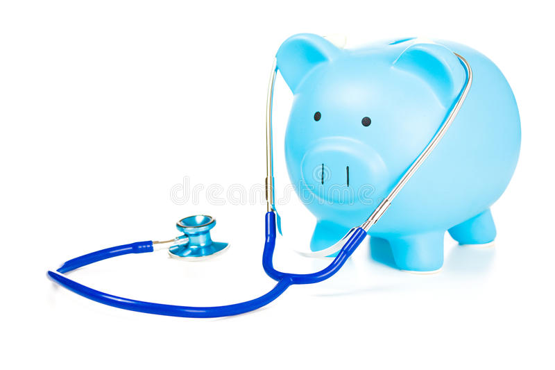 Isolerade spargris och stetoskop på vit bakgrund royaltyfri bild