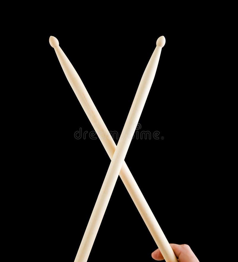 isolerade svarta drumsticks royaltyfri foto