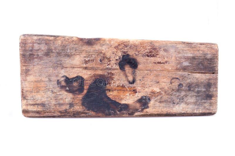 Isolerat gammalt wood bräde som ridas ut royaltyfria foton