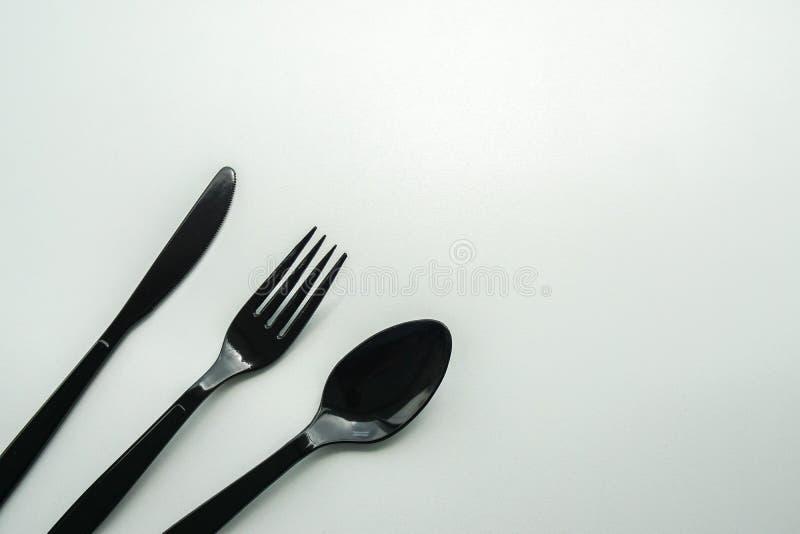 Isolerat svart plast- bestick för mål royaltyfria foton