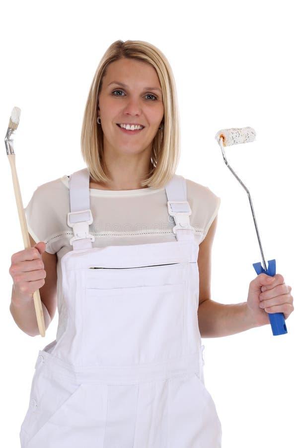 Isolerat ungt kvinnligt jobb för kvinna för husmålare och dekoratör royaltyfria foton