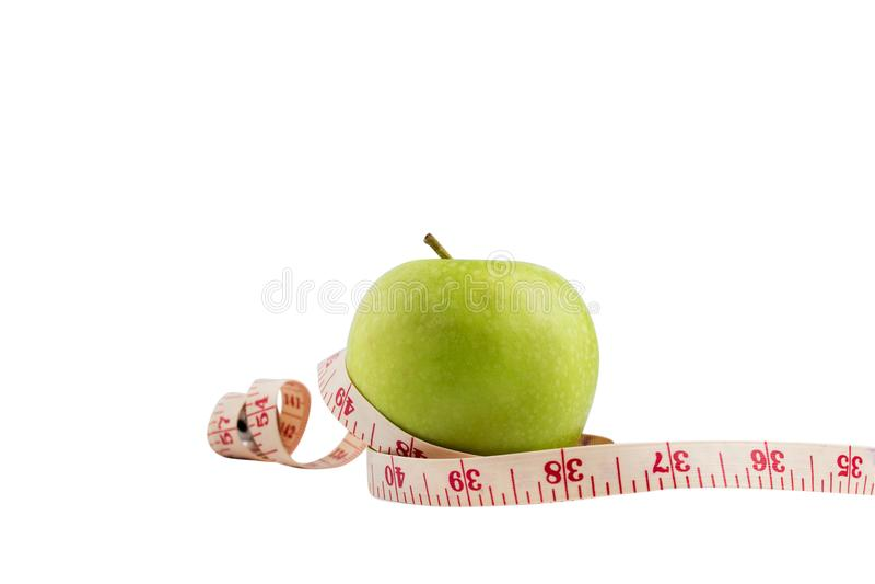 Isolez la pomme verte sur le bakcground blanc avec l'arou de mesure de bande photographie stock