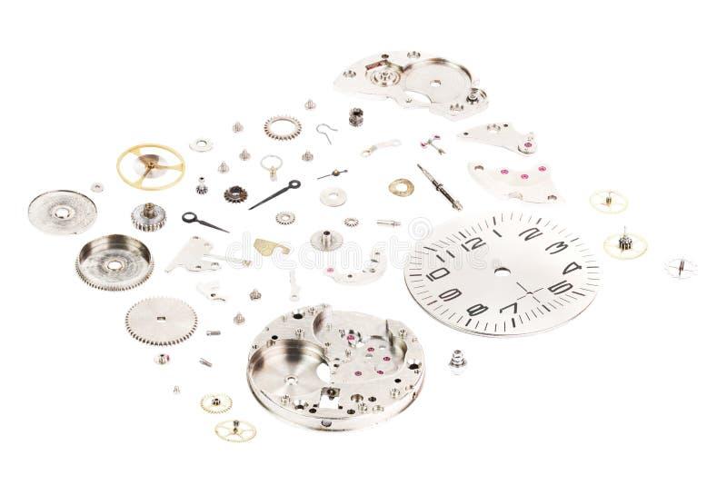 isometric Relógio de pulso mecânico velho desmontado isolado no fundo do whithe imagens de stock