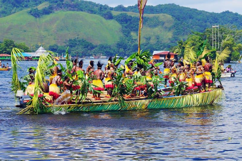 Isosolo dancers. Traditional dance Papua in sentani lake stock photos