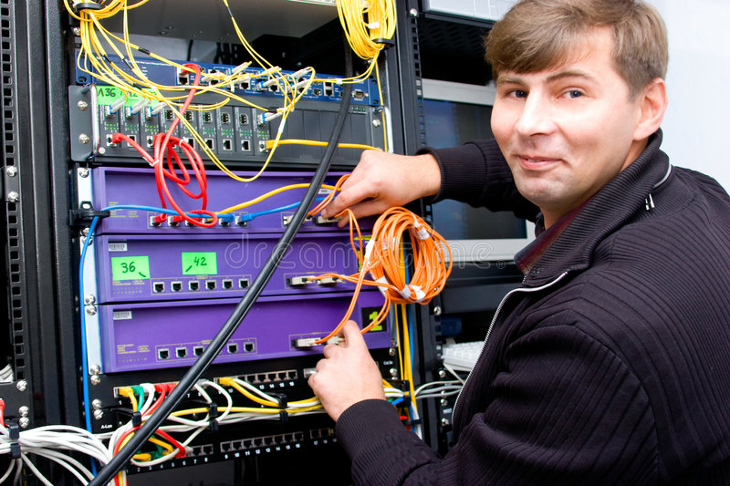 ISP. Technician working on server rack royalty free stock image