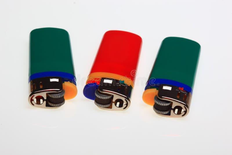Isqueiro, chaminés de gás do plástico fotografia de stock