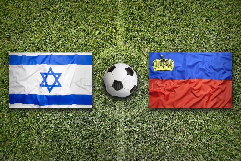 Israël versus De vlaggen van Liechtenstein op voetbalgebied royalty-vrije stock afbeelding