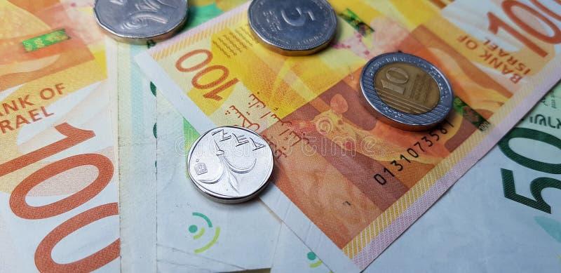 Israëlische nieuwe sjekelsbankbiljetten van 100, 50 en muntstukken van 5, 10, 1