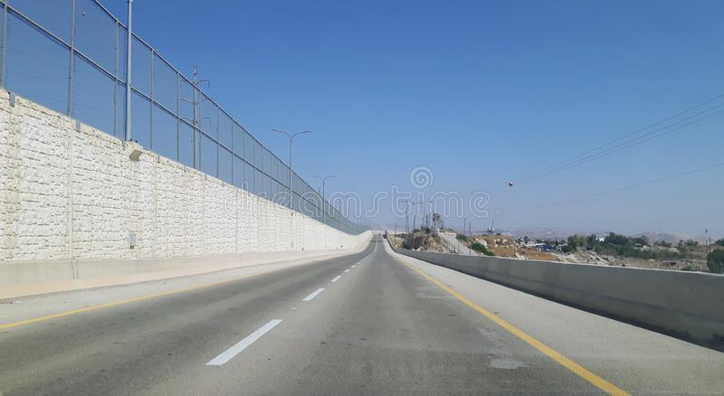 Israel apartheid road near Jerusalem. Road 4370, which is allowed only for residents of Israel, though it is in Palestinian territory. See separation wall on the stock photos