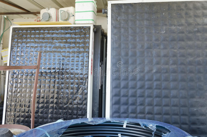 Israel, Beer-Sheva -New mirrors for solar water heaters. Middle East- Mitzpe Ramon, Israel. February 29,The installation of new solar water heaters companies Hom royalty free stock image