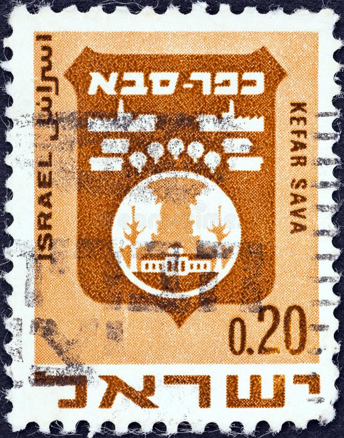 ISRAEL - CIRCA 1969: A stamp printed in Israel shows coat of Arms of Kefar Sava, circa 1969. ISRAEL - CIRCA 1969: A stamp printed in Israel from the `Civic Arms stock photo