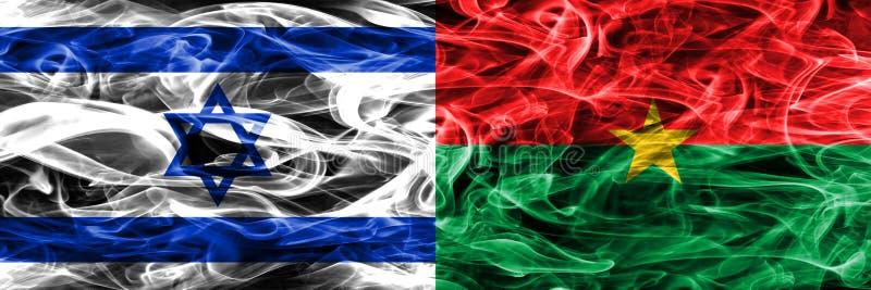 Israel contra as bandeiras do fumo de Burkina Faso colocadas de lado a lado israeli fotografia de stock