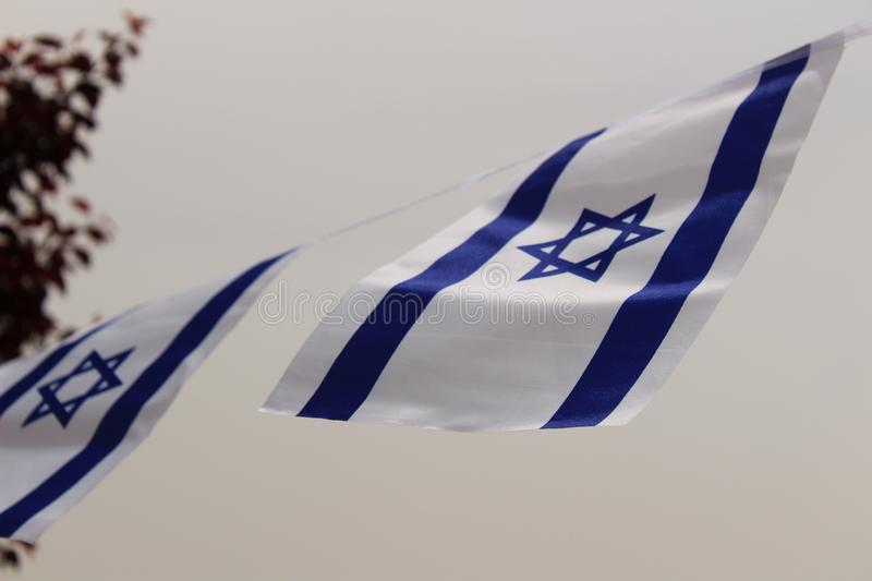 Israel flag blowing in the wind stock photography