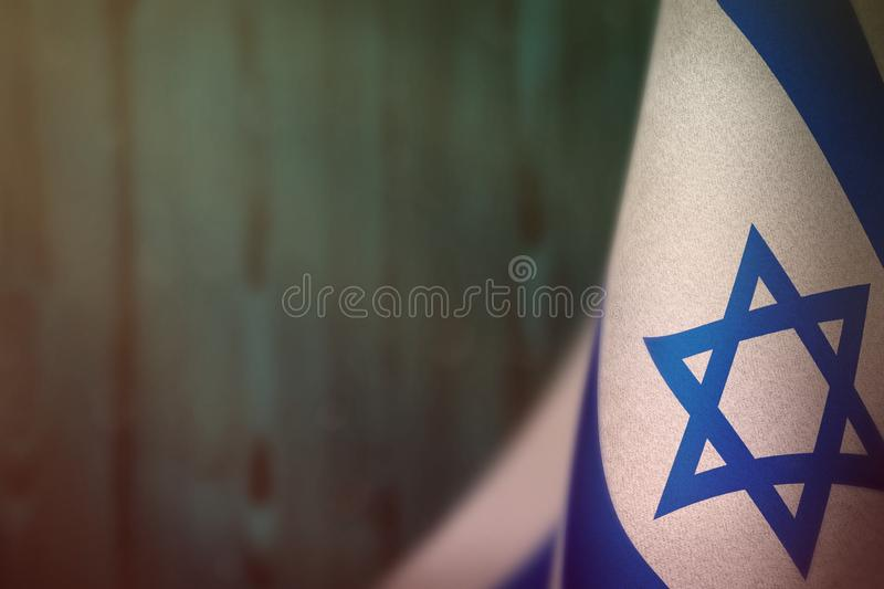 Israel flag for honour of veterans day or memorial day. Glory to the Israel heroes of war concept on light blue blurred natural. Israel hanging flag for honour stock image