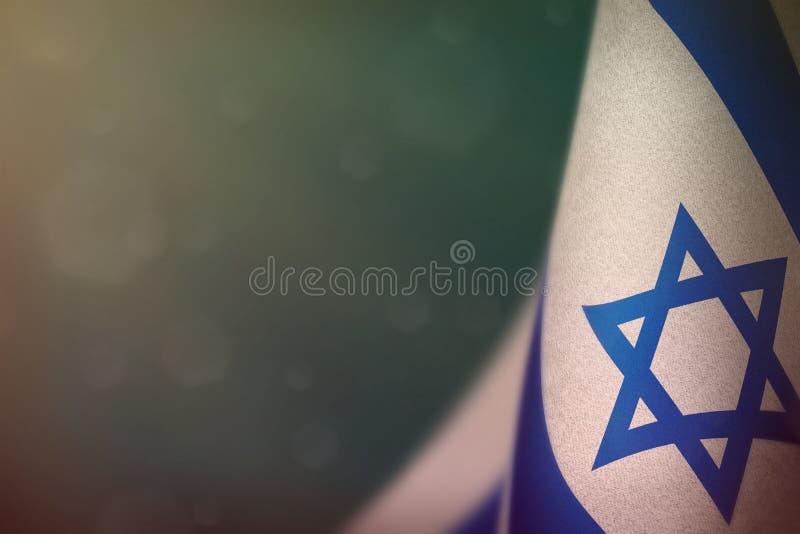 Israel flag for honour of veterans day or memorial day. Glory to the Israel heroes of war concept on light blue dark velvet backgr. Israel hanging flag for stock image