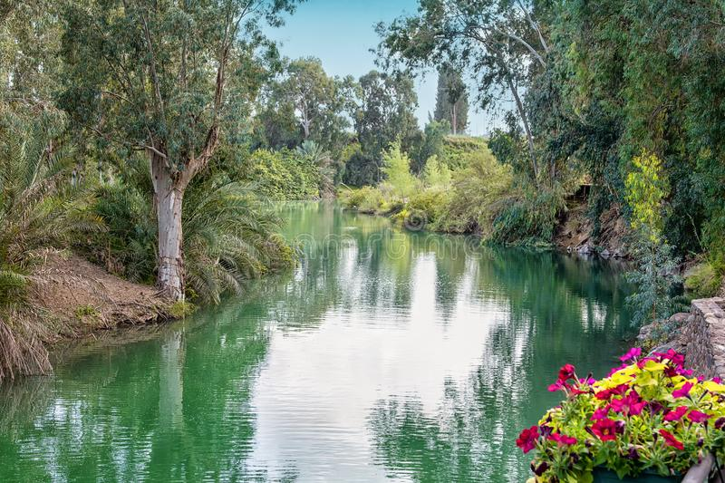 Israel, the Jordan River - December 5, 2016: according to the Gospel, Jesus Christ was baptized in the waters of the holy river stock photography