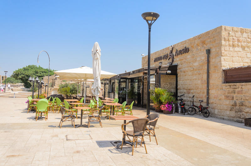 ISRAEL -July 30, - Аn open-air restaurant in the summer park in Caesarea, Israel- Caesarea , 2015. ISRAEL -July 30, - an open-air restaurant in the summer stock photography