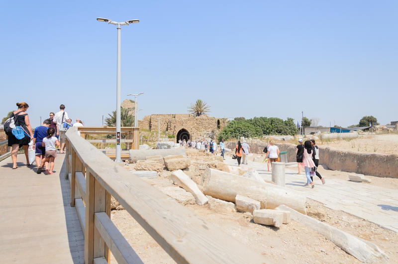 ISRAEL -July 30, Tourists are going to be released in the park Caesarea, summer - columns, Greek, Byzantine,- 2015 in Is. ISRAEL -July 30, Tourists are going to royalty free stock photo