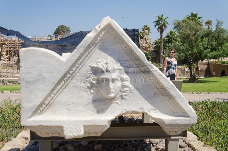 ISRAEL -July 30, - Tourists walk along the ancient Byzantine park in Caesarea, a triangular pattern of white marble, Israel 2015. 2015 in Israel stock photos