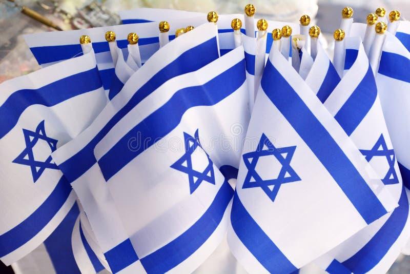 Israel nationsflaggor arkivfoto