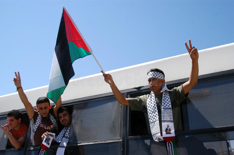 Israel releases 255 Palestinian prisoners. RAMALLAH,PA - JULY 20:Freed Palestinian prisoners wave flag and flash V on July 20,2007.The release was a goodwill stock photos