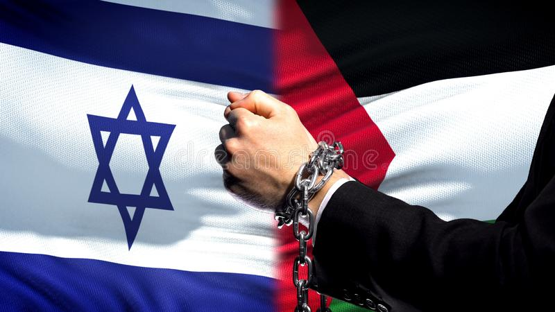 Israel sanctions Palestine, chained arms, political or economic conflict, ban. Stock photo stock photos