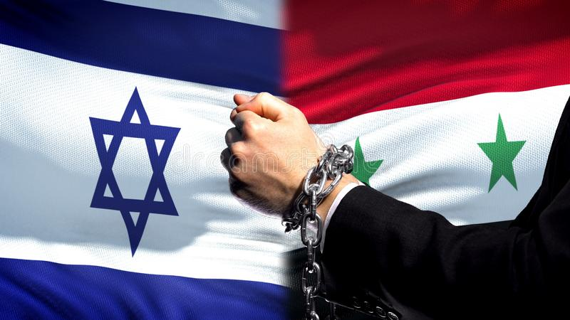 Israel sanctions Syria, chained arms, political or economic conflict, trade ban. Stock photo stock photo
