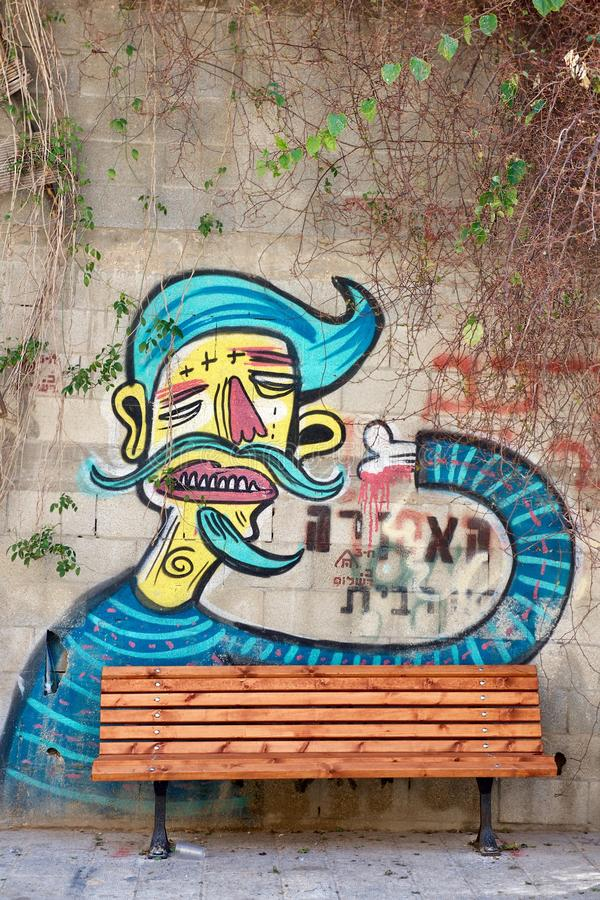 Israel. Tel Aviv. Old city. Graffiti. Graphic image of a man on a brick wall with a bone instead of a hand, with a mustache and a beard stock photos