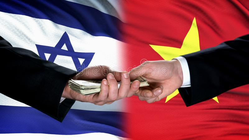 Israel and Vietnam officials exchanging money, flag background, partnership. Stock photo stock photos