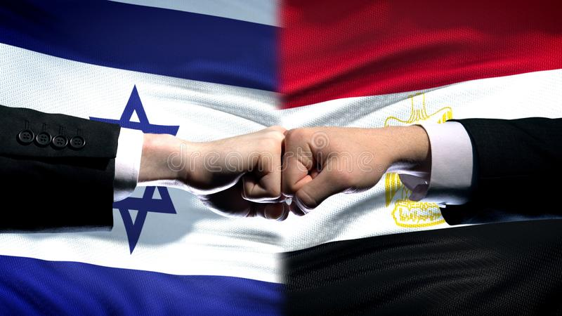 Israel vs Egypt conflict, international relations, fists on flag background. Stock photo stock photos