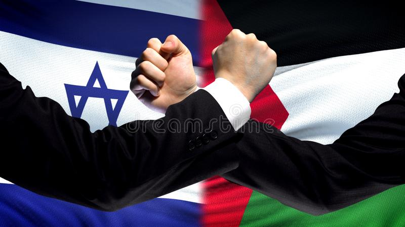 Israel vs Palestine confrontation, religious conflict, fists on flag background. Stock photo stock photos