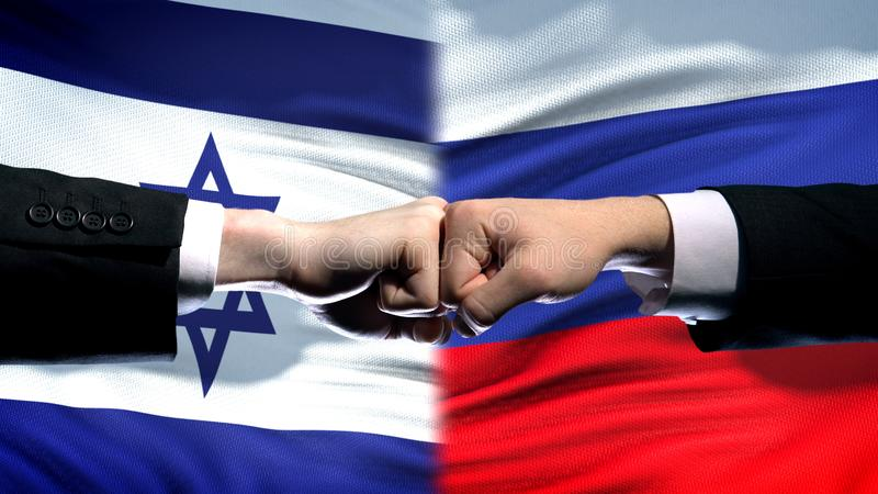 Israel vs Russia conflict, international relations, fists on flag background. Stock photo royalty free stock photo