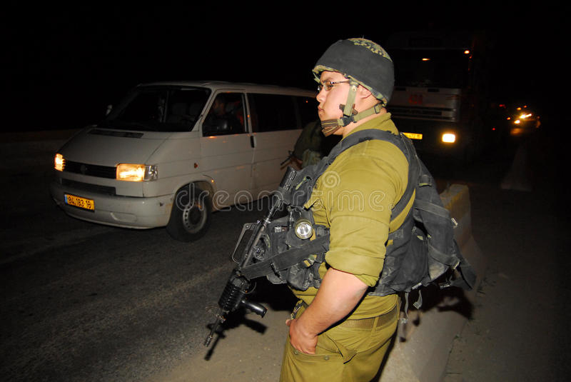 Israeli checkpoint. WEST BANK, ISR - MAR 05:Israeli soldier checks Palestinians vehicles on Mar 5, 2008.Since the 90s Israel has created hundreds of permanent royalty free stock photo